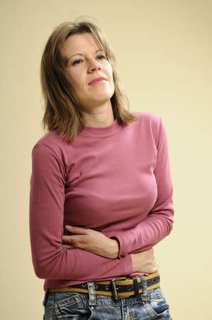 woman suffering of stomachache Stock Photo