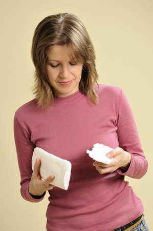 sanitary napkins and tampons: woman choosing tampons