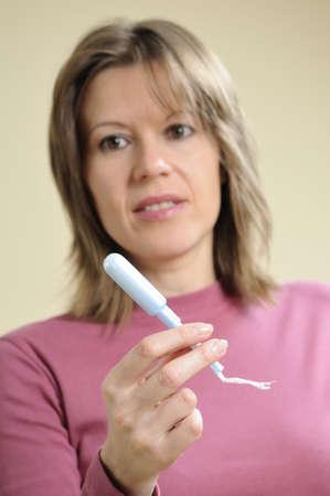 premenstrual: white adult showing applicator Stock Photo