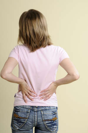 woman suffering from back pain Stock Photo