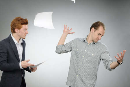 employee throwing papers Stock Photo - 8366470