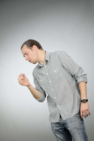 unhealthy man coughing photo