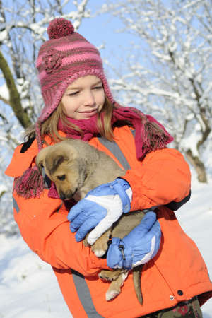 cheerful girl carrying baby animal  Stock Photo - 8447899