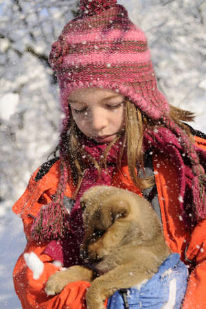 snowing on baby dog and child