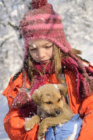 snowing on baby animal and white child