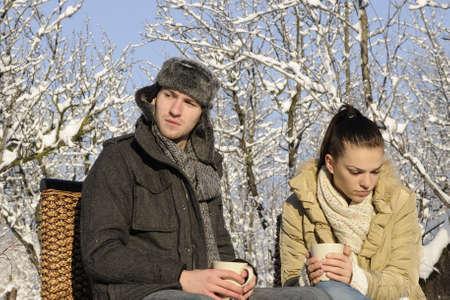 upset teens drinking tea Stock Photo