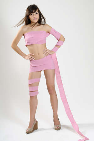 woman sandals: girl wrapped in pink toilet paper