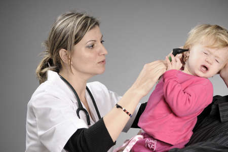 doctor studying baby ear