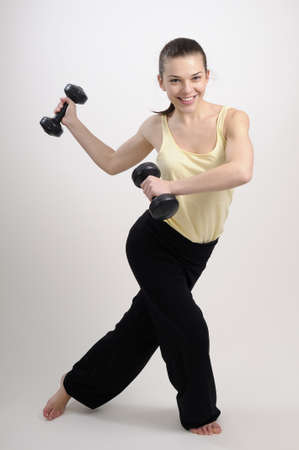 woman working body with dumbbells Stock Photo - 8756318
