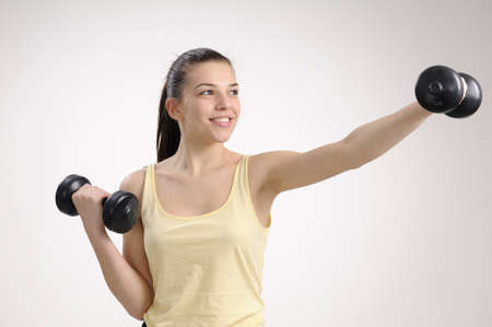cheerful fitness instructor training her body Stock Photo - 8756321