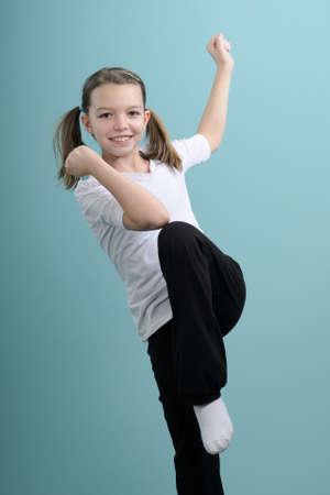 happy child exercising sports movements Stock Photo