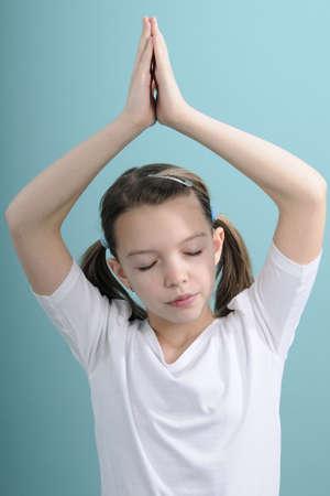 girl concentrating for yoga exercises Standard-Bild