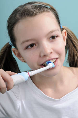 child brushing teeth with toothbrush