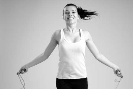 woman jumping rope photo