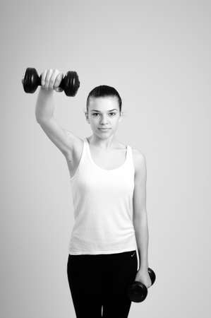 fitness instructor working with dumbbells photo