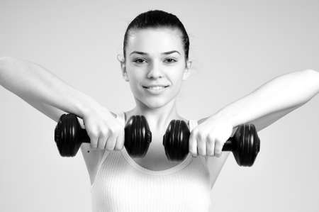 white woman exercising with dumbbell photo