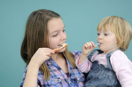 kids cleaning teeth with toothbrush photo