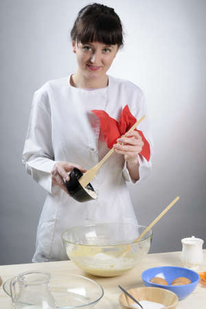 smiling woman cooking food Stock Photo - 9186258