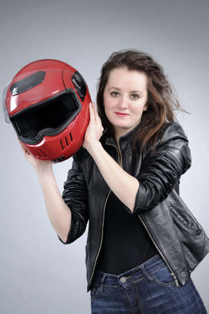 motorcyclist: smiling young motorcyclist woman posing Stock Photo