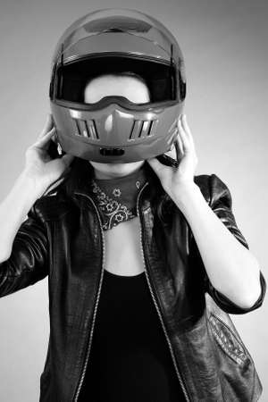 young person arranging helmet photo
