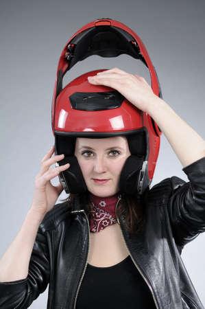 visor: motorcyclist woman arranging visor Stock Photo