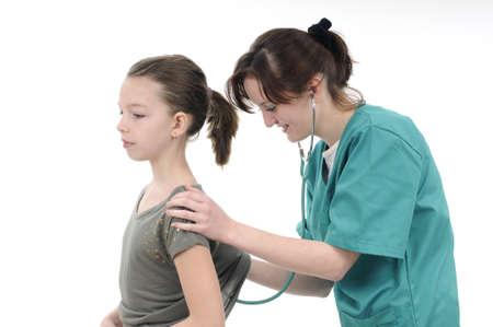 Doktor examining Mädchen Standard-Bild - 9262701