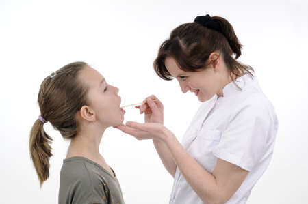 doctor studying teenager mouth with medical tool