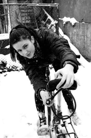 girl bicycling in winter photo