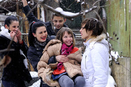 group of young people having fun with snow photo