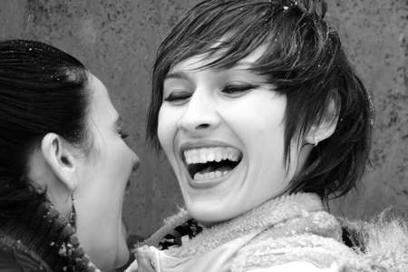 teenagers laughing: young women laughing in winter Stock Photo