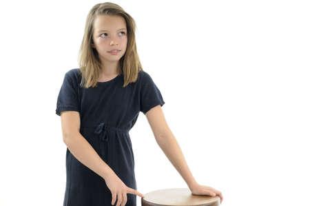 beautiful girl posing near chair Stock Photo