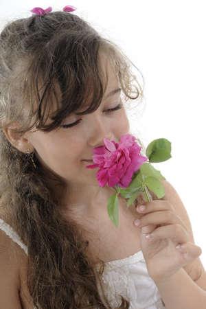 blonde girl smelling rose photo