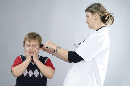 doctor examining sick child photo