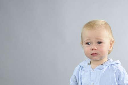 sad baby boy crying photo