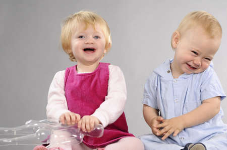 beautiful babies laughing and playing together Stock Photo - 9739541