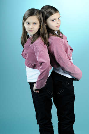 two twins posing together photo