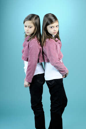 twin girls having conflict photo