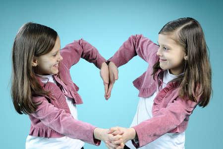 similar children creating heart photo