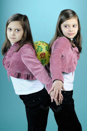 twin children playing with ball photo