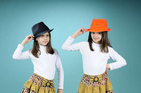 two funny twins saluting with hats