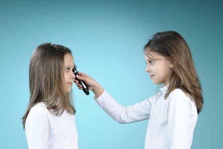 beautiful twin friends brushing hair photo