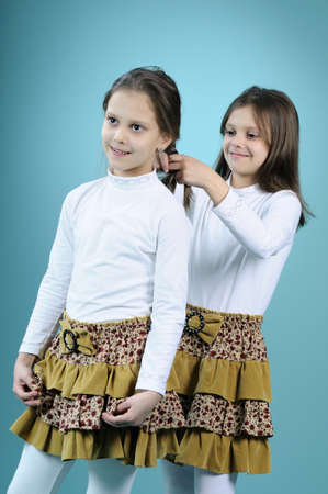 beautiful twin arranging her sister hair Stock Photo