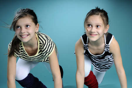 young gymnasts practicing together Stock Photo