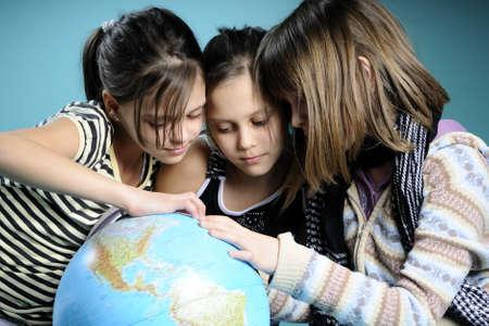 white children studying globe Standard-Bild