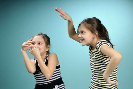 funny twin children having fun at party Stock Photo