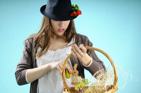 girl searching eggs in basket