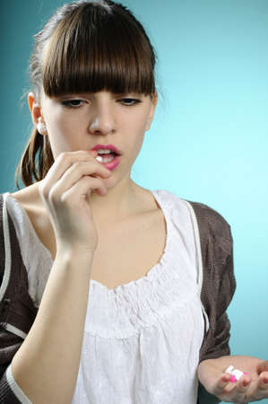 girl taking medication Stock Photo