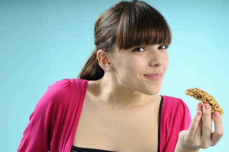 girl eating cereals bar photo