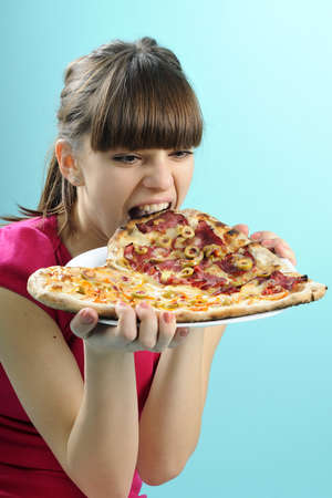 hungry girl eating pizza