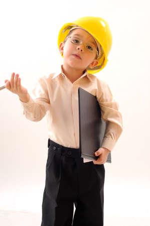little engineer studying photo